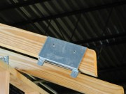 HUGS Quick Bracket is designed to fit over truss boards to install the HUGS Bracket. The Quick Bracket installs with nails (not included) and is made of galvanized steel. Choose bracket for board sizes 2